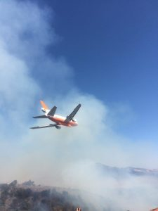 A firefighting airplane preparing to make a drop over the burning Soberanes Fire